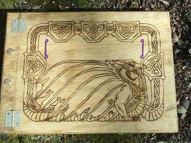 Free Name Engraved between the purple brackets above the Celtic Dragon