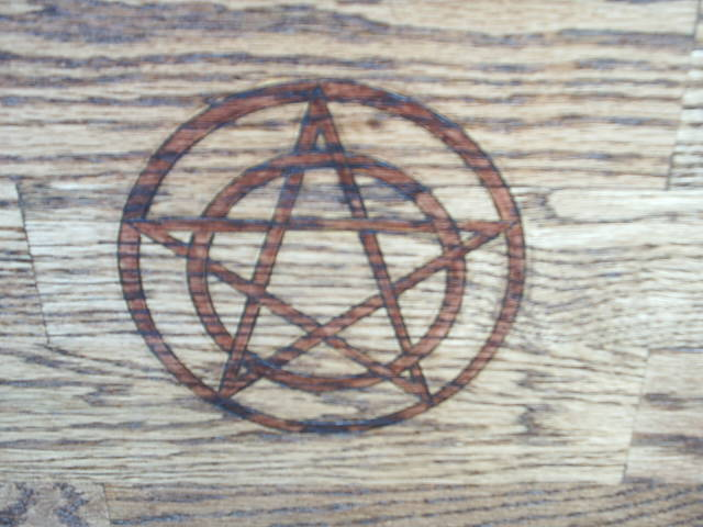 Pentacle representing protection on front door.