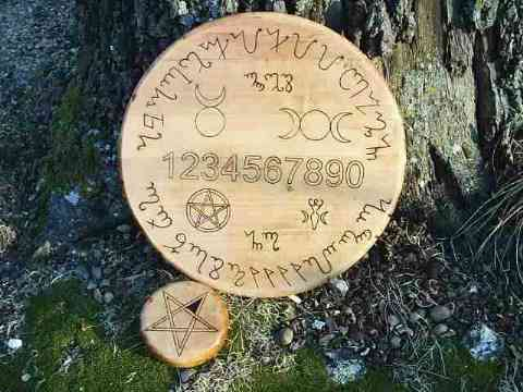 Theben is the Witches Language, Board is 13 inches across which is a significant number of the moon and the other world.