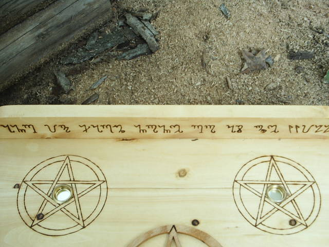 Theban script And It Harm None Do As Ye Will on this Wiccan Altar